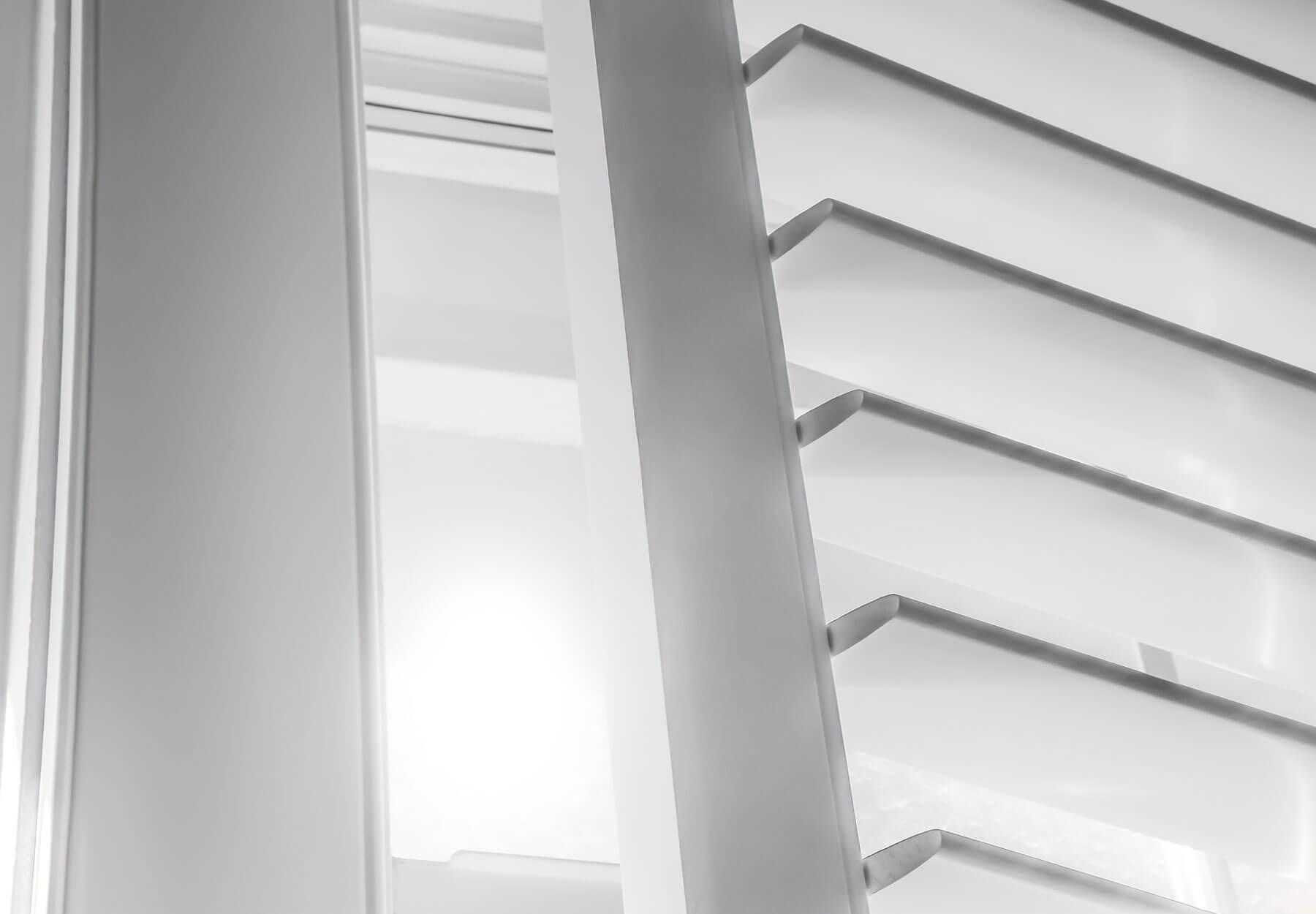 A close-up of vinyl shutters