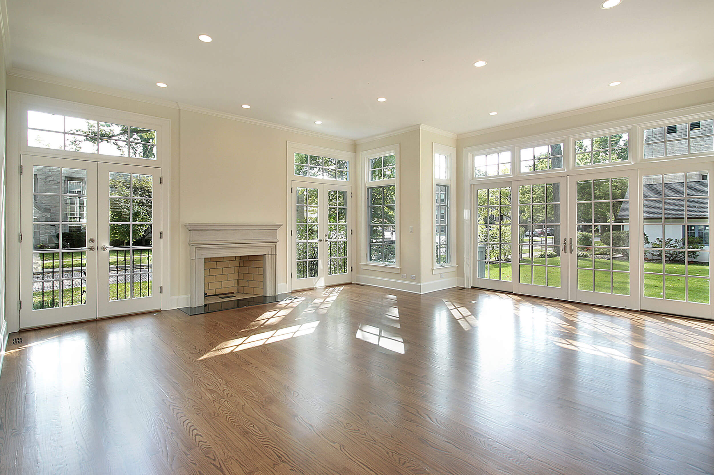 An open, well lit room with a fireplace.