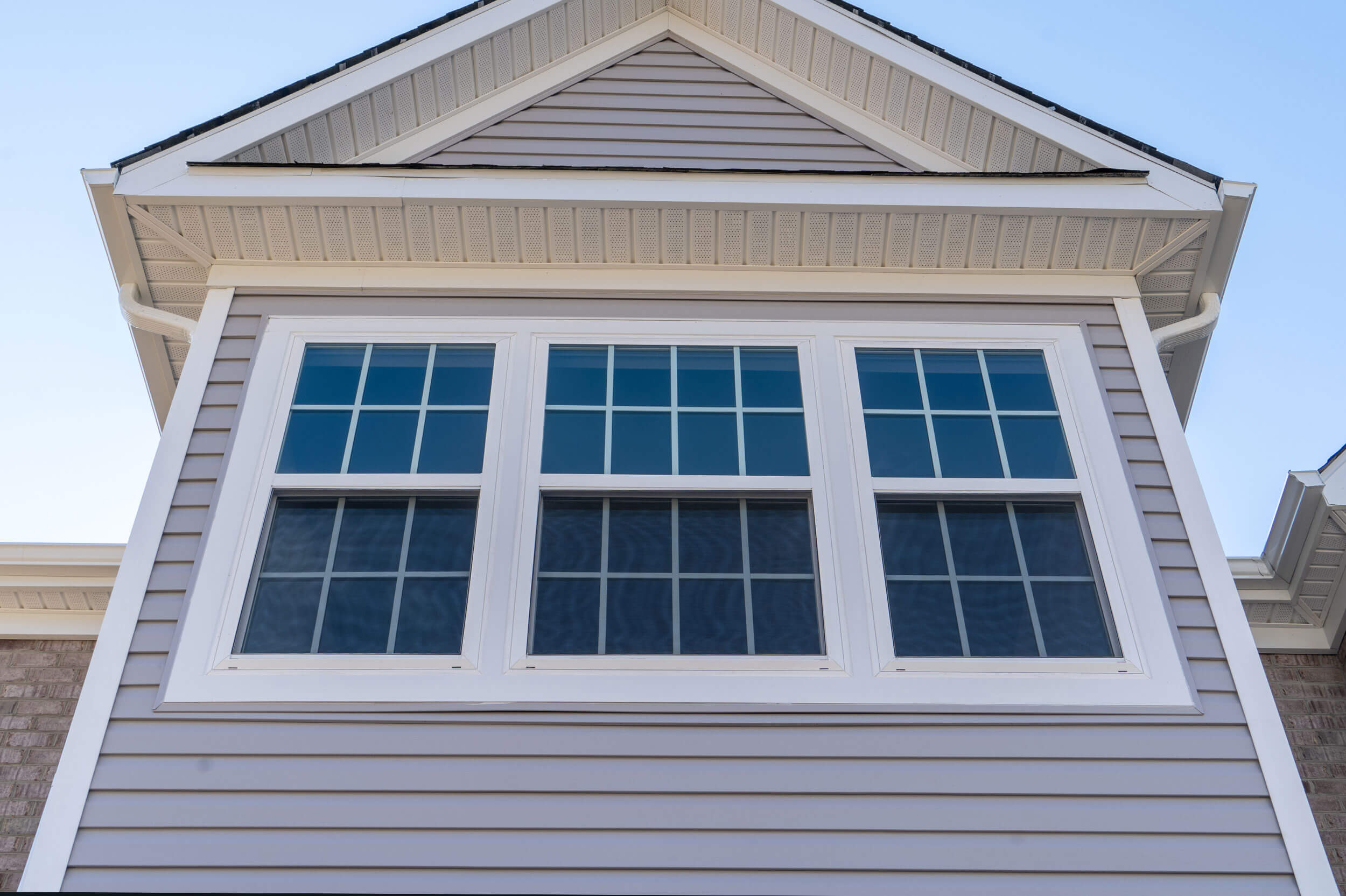 An outdoor view of a house's windows